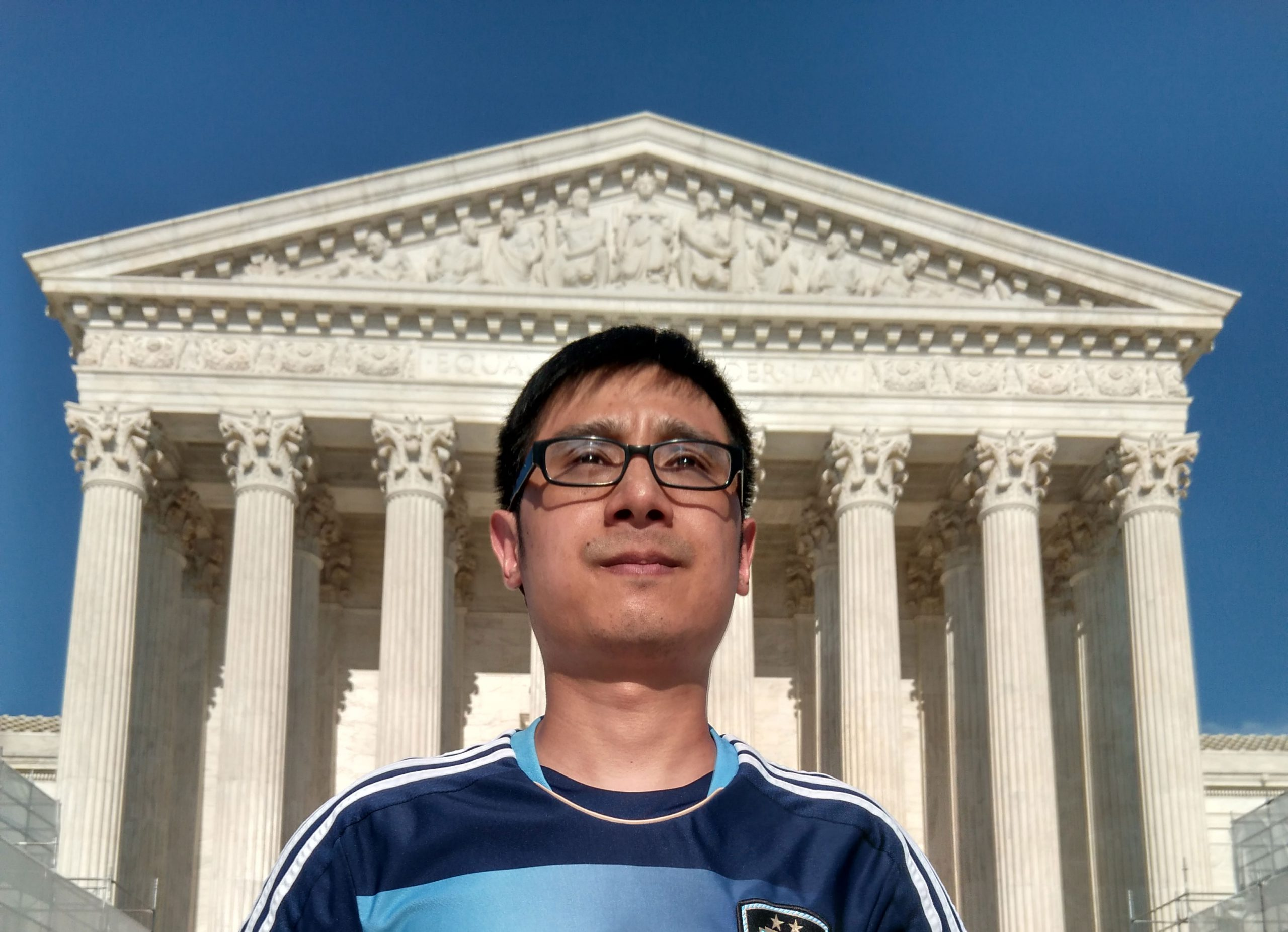 Jun in front of Supreme Court building